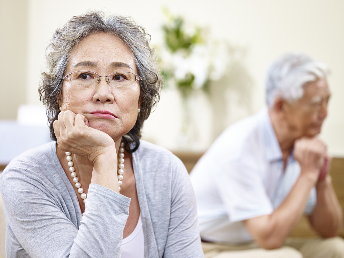 unhappy senior asian couple