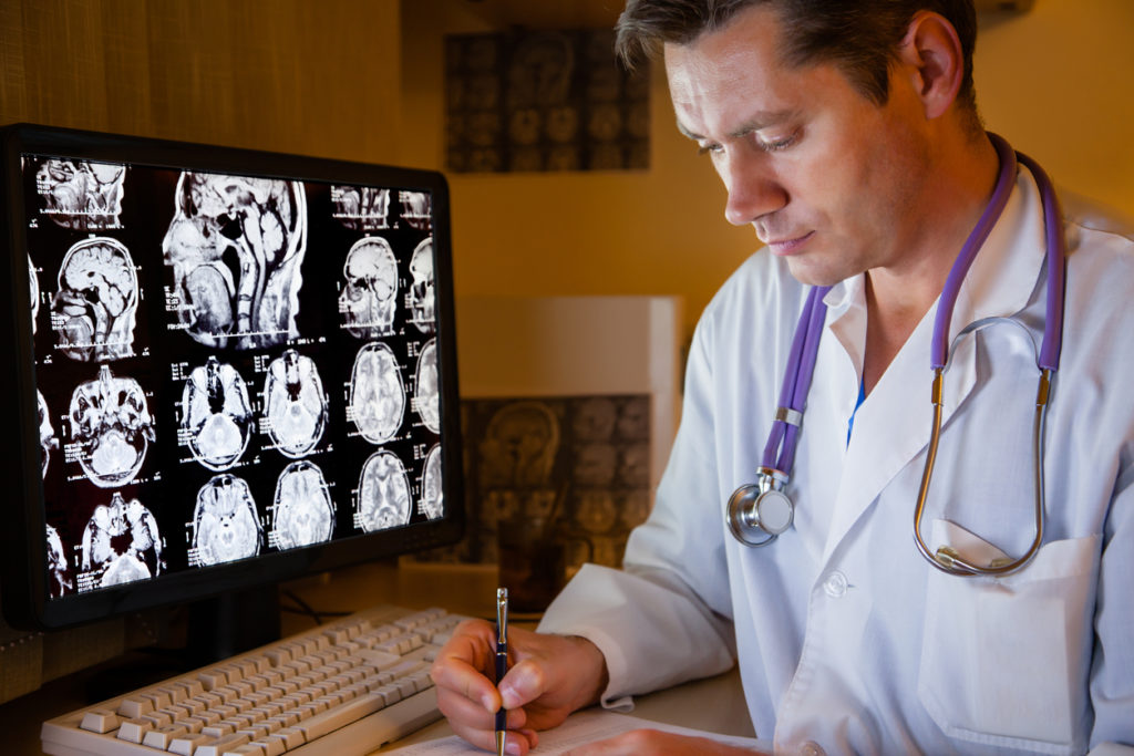 Medical doctor in front of a computer