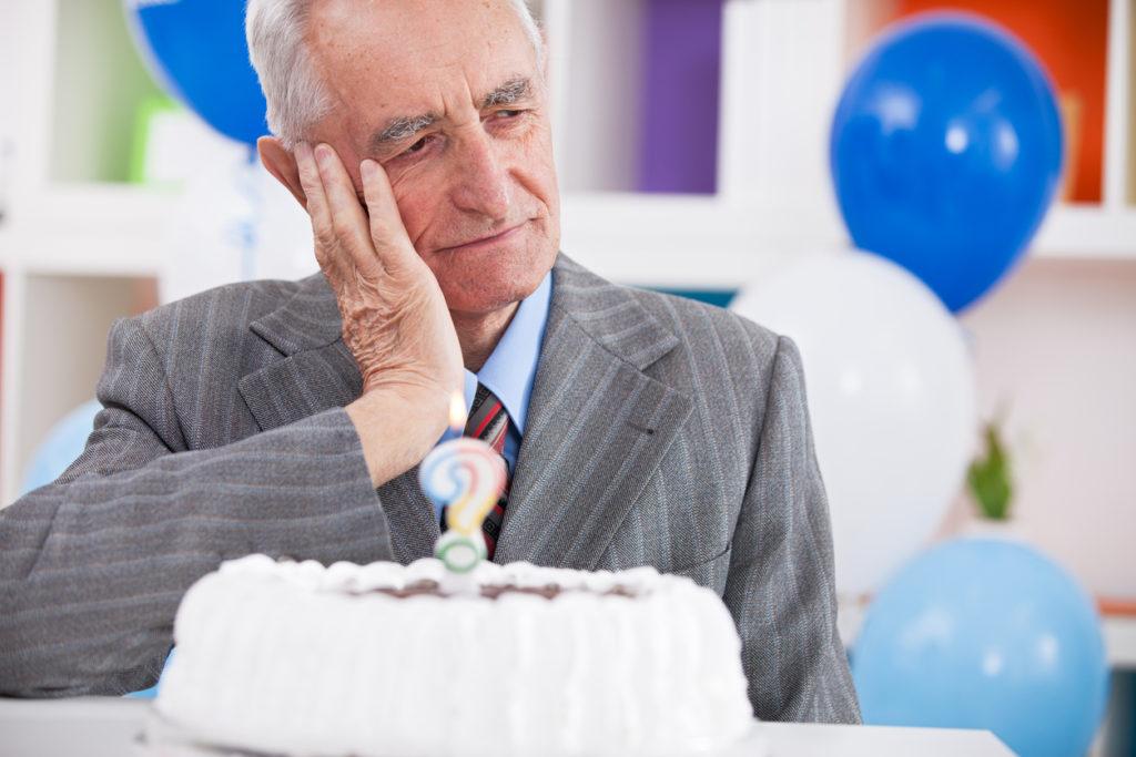 Sad senior man forgot how old is