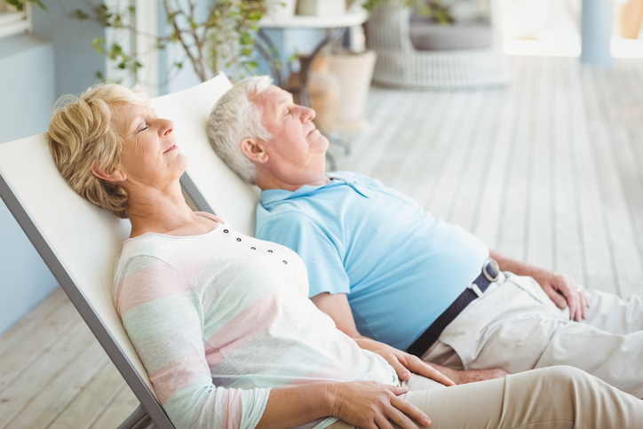 Senior couple relaxing on lounge chair