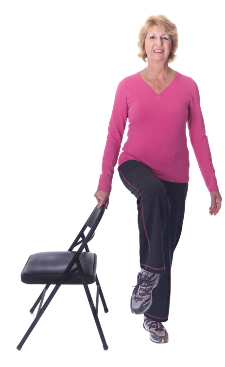 Senior woman balancing on one leg