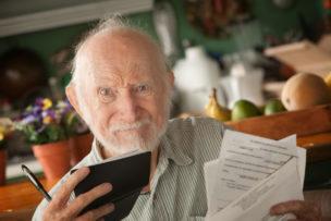 Senior man with many bills