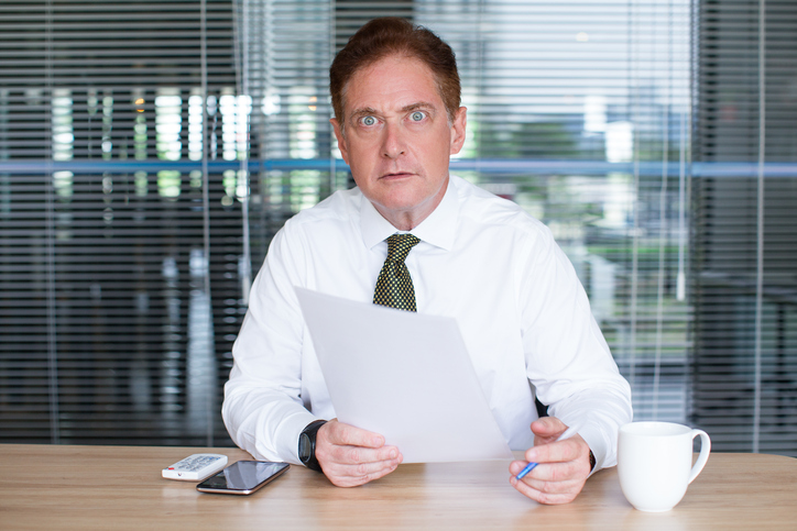 Shocked Mature Business Man Working at Desk