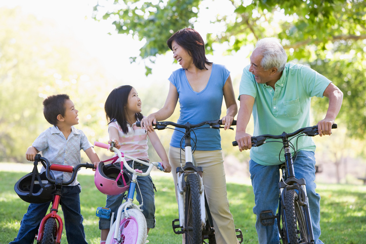 Grandparents bike riding with grandchildren