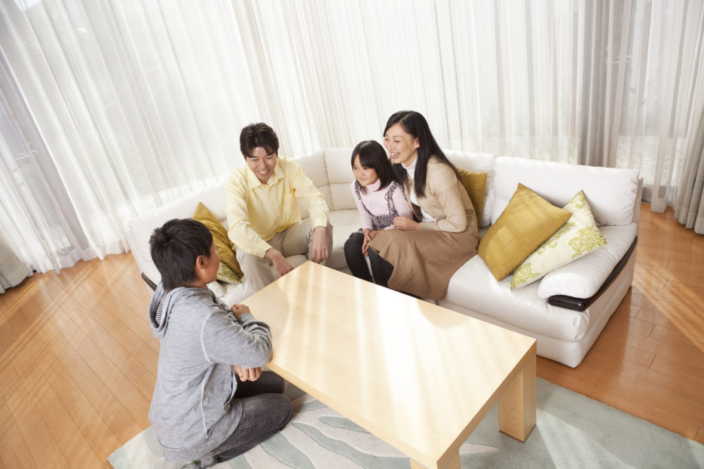 Japanese Family Relaxing in Their Home
