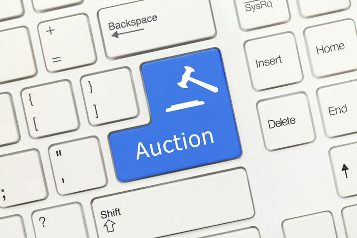 White conceptual keyboard - Auction (blue key)