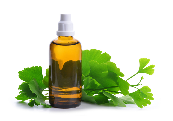 Extract from the ginkgo in bottle with green leaves.