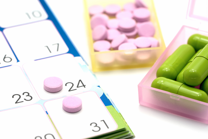 Medical pills capsule in pill box with calendar