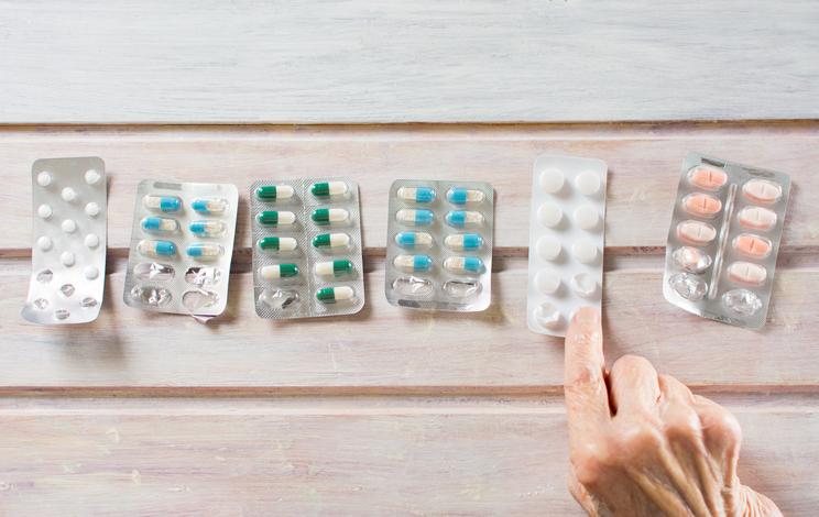 Senior woman picking her today pills