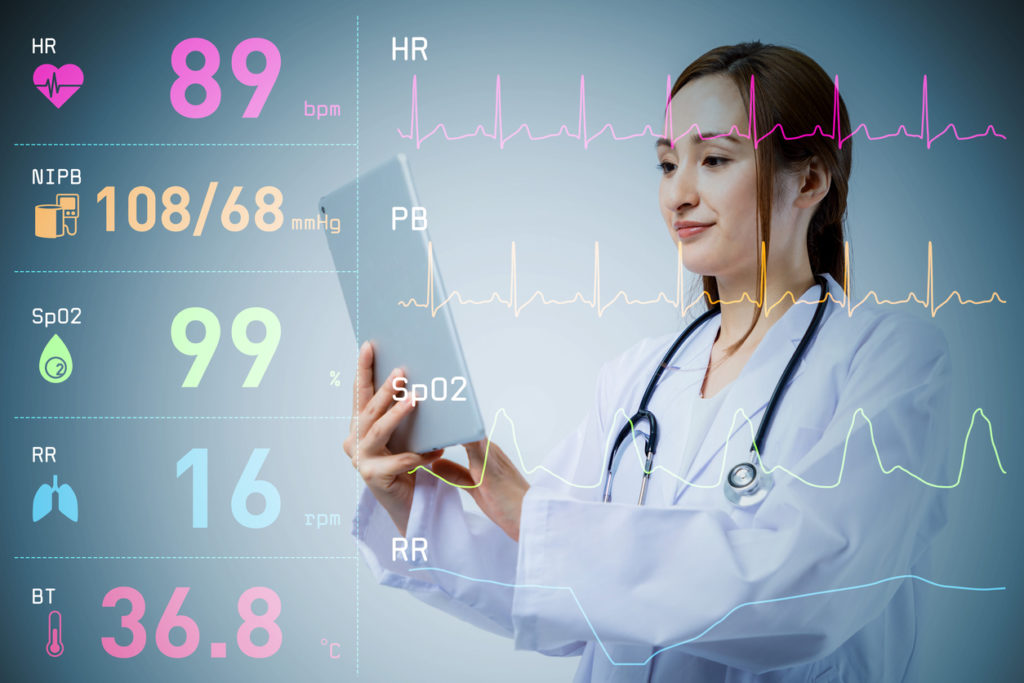 young lady doctor and various vital sign wave form. medical technology concept.
