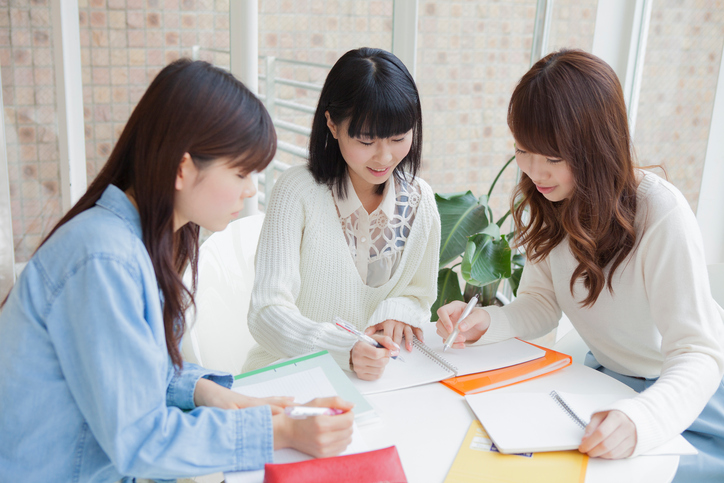 Three young Japanese women studying