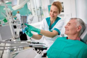 Dentist showing teeth problem on dental X-ray