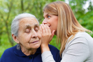 Whispering a secret to grandma's ear
