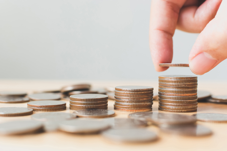 Saving money and investing is growing growth wealthy and sustainable for the future concept, Hand of male or female putting coin stack step growing growth financial