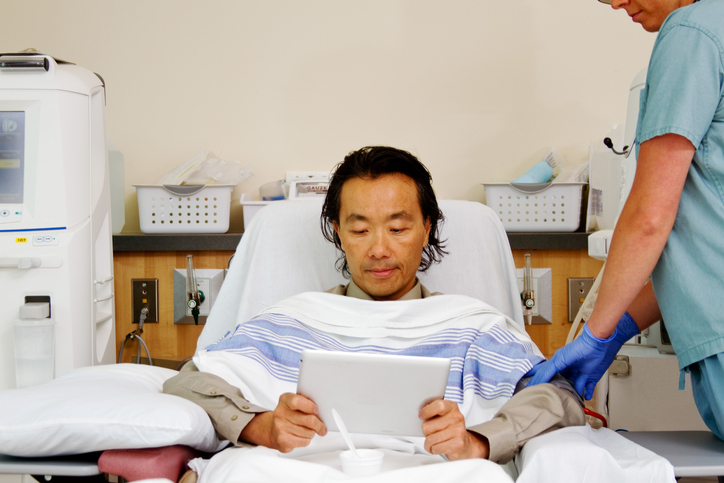 Asian patient receiving dialysis
