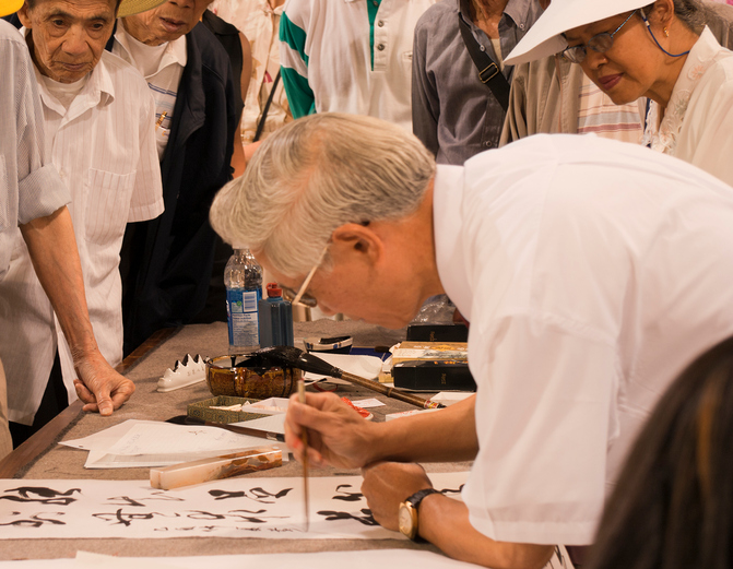 Mature artist painting chinese calligraphy