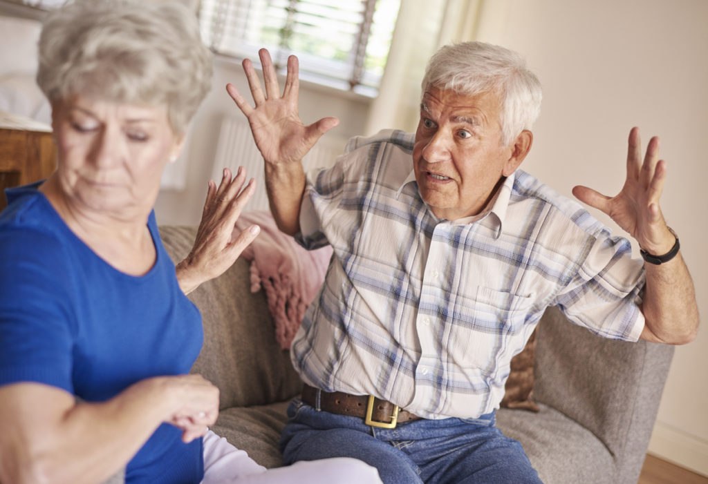 Argument between senior couple in the living room