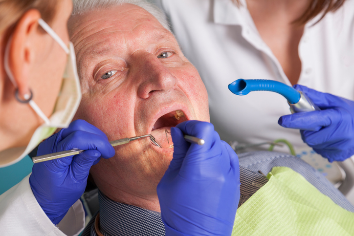 senior man at dental treatment