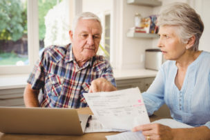 Worried senior couple discussing their bills