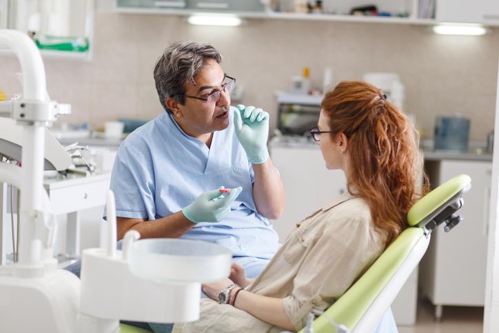 Senior male dentist in dental office