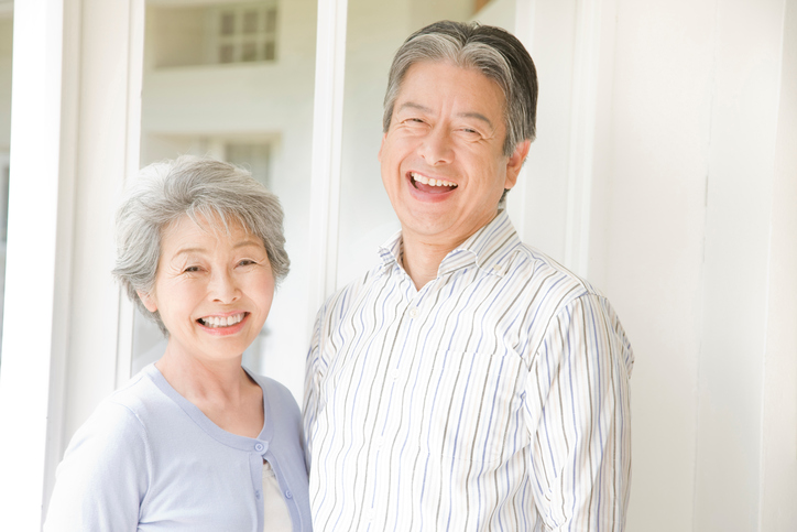 An elderly couple have to laugh