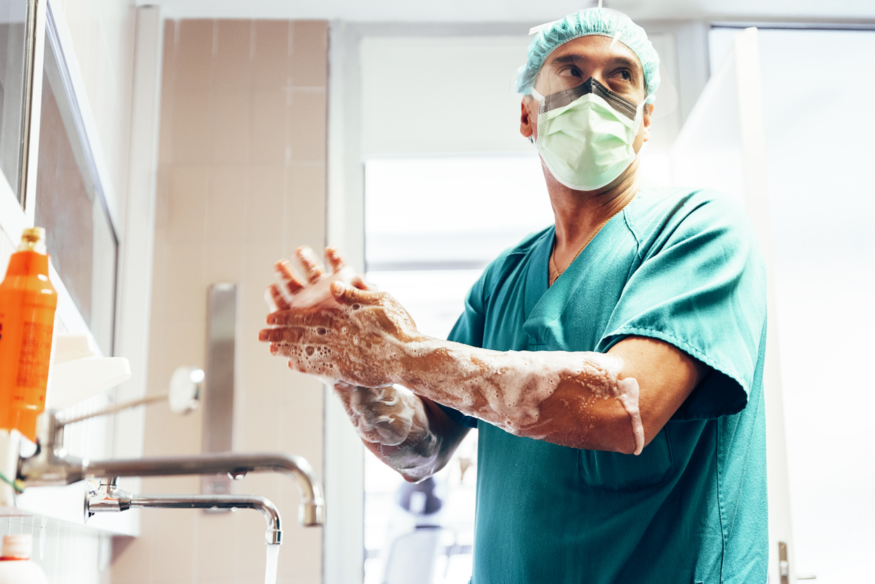 doctor washing hands before operating