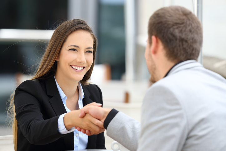 Executives handshaking in a coffee shop