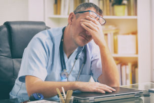 Overworked doctor in his office