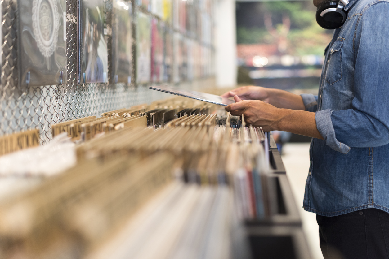 Man browsing vinyl album in a record store