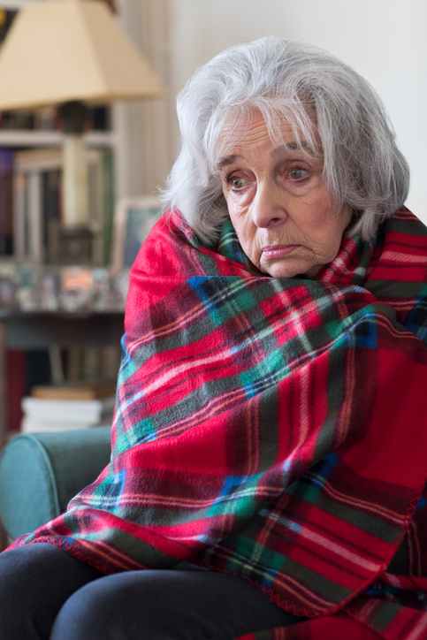 Senior Woman Wrapped In Blanket Unable To Afford Heating Bills