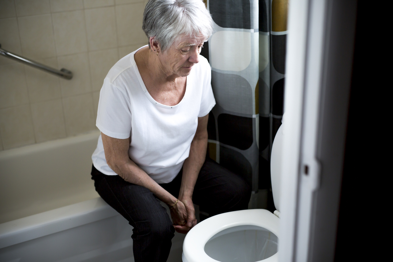 Retirement woman fell down in a restroom