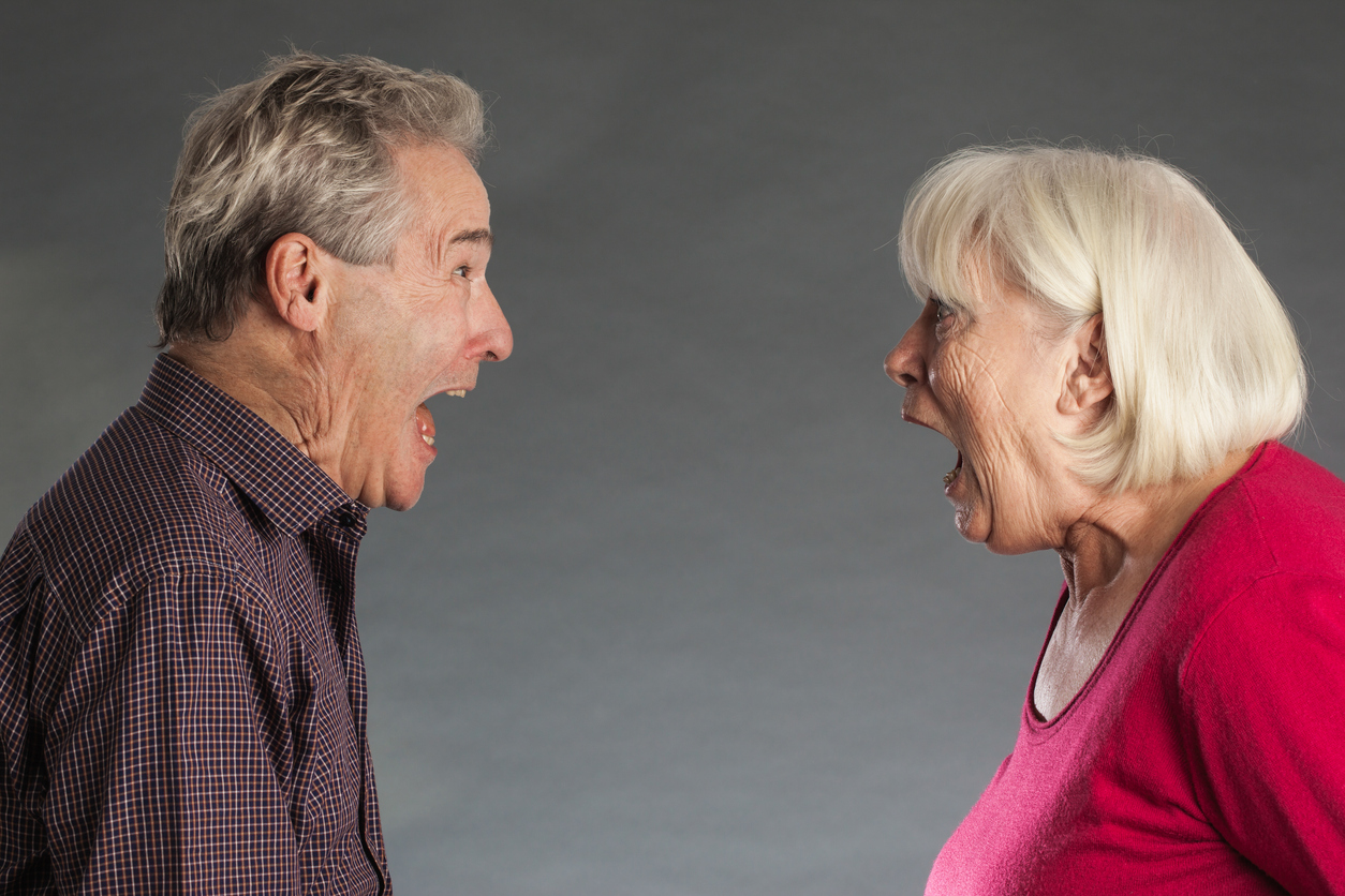 Senior couple, shouting at each other.