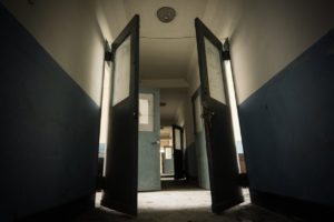 Dark hallway in a scary and possibly haunted abandoned sanatorium from the 1930s