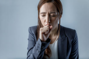 coughing woman. catching a cold. health care concept.