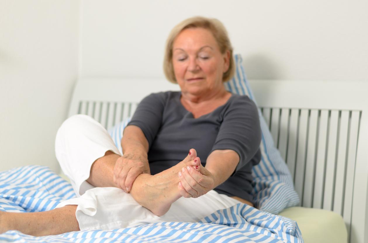 Senior lady massaging her foot