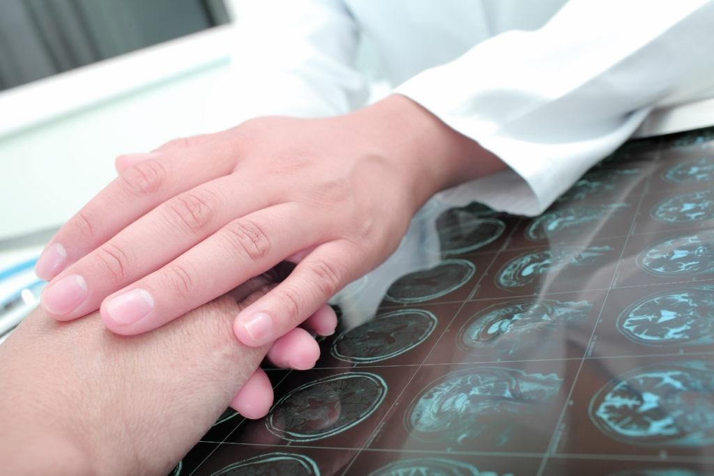 Doctor keeps hands of his patient