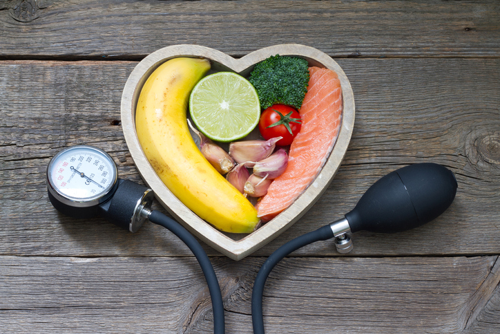 Health heart diet food concept with blood pressure gauge