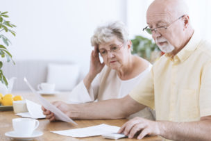 Sad elderly marriage with documents
