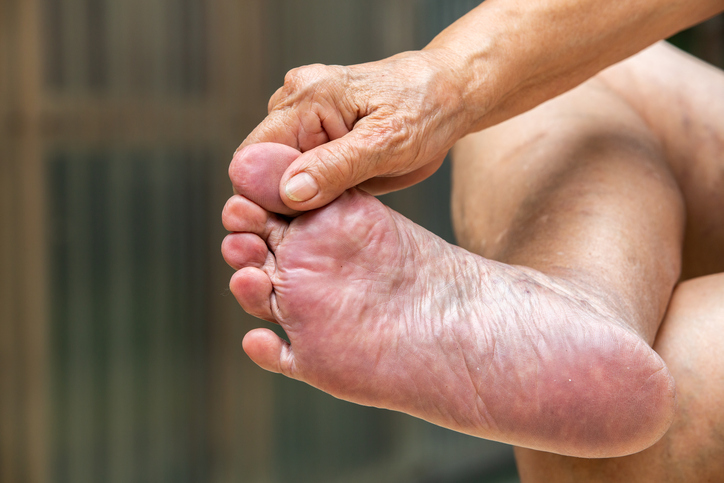 Senior woman's hand massaging her foot, About massage concept