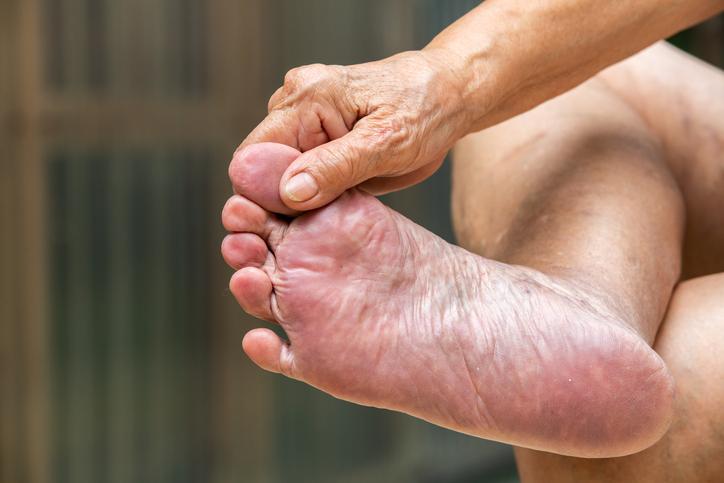 Senior woman's hand massaging her foot, About massage concept