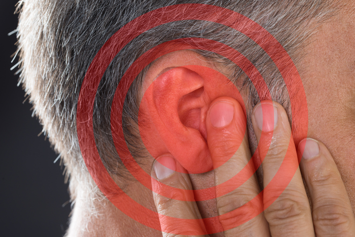 Man Covering Ear With Hand