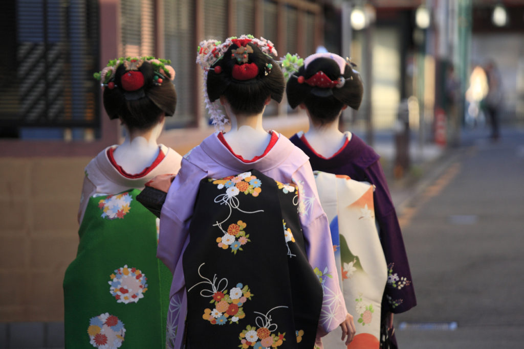 Back view of three geishas