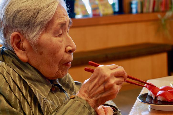 Grandmother enjoy Sushi
