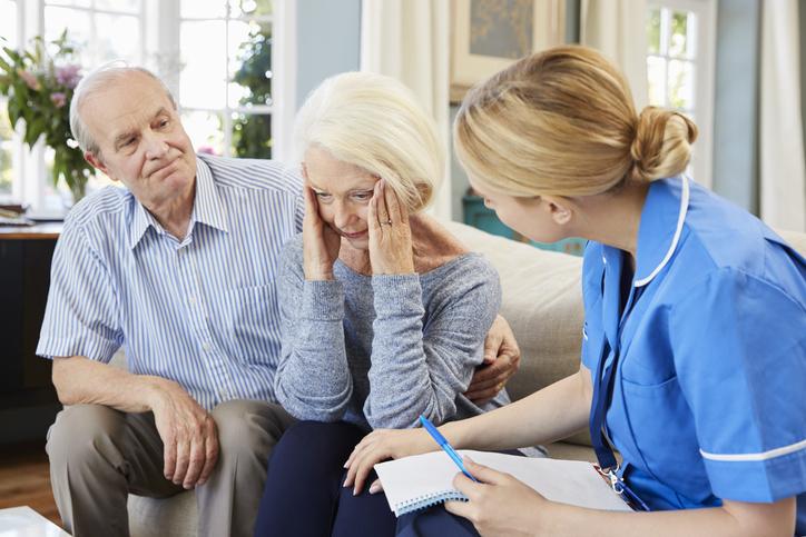 Community Nurse Visits Senior Woman Suffering With Depression
