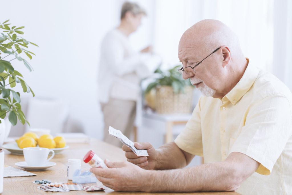 Man reading his medicines' prescription