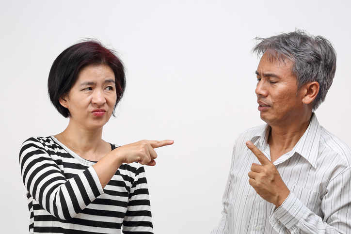 woman pointing her finger against and blame her husband