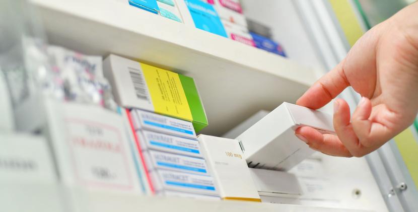 Closeup pharmacist hand holding medicine box