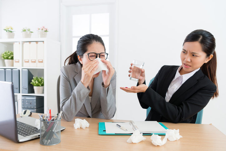 female business woman sneezing during conference