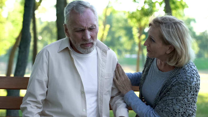 Senior man feeling unwell, dizziness and weakness, scared wife supports husband