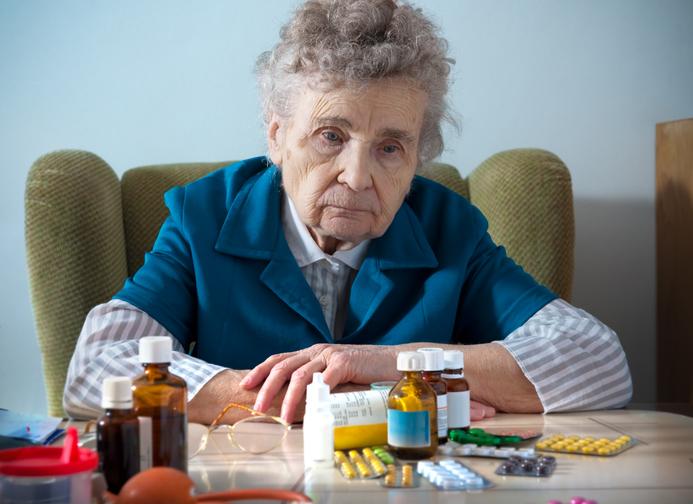 senior woman and medicine